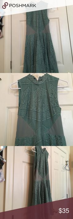 Francesca green dress new w/ tags size L Amazing green lace detailed Francesca dress with tags! Zips up back never worn, this dress is for someone who likes a lot of detail because this dress has it all Francesca's Collections Dresses Midi