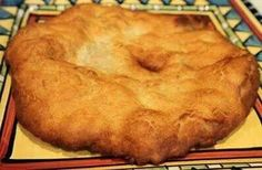 "INDIAN FRY BREAD: 4 c flour, 1 T baking powder, 1 t salt, 2 T powdered milk, 1 1/2 c warm water, 1 cup shortening, extra flour for your hands. Mix first 4 ingred in bowl, add warm water to form a dough. Flour hands. Knead dough by hand til soft but not sticky. Cover w cloth and let stand 15 min. Shape dough into 2"" balls, then flatten by patting and stretching. Melt shortening about an inch deep in pan and fey bread, first one side, then the other. Top with honey, cinnamon sugar, or make…"