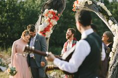 Round Mountain Texas Wedding - love the idea of prettying up the tree trunk with flowers!