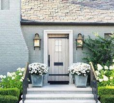 grey brick exterior with plank wood door! Enchanting grey brick exterior with plank wood door!, Enchanting grey brick exterior with plank wood door! Exterior Paint Colors, Exterior Design, Interior And Exterior, Gray Exterior, Exterior Homes, Cottage Exterior Colors, Grey Siding, French Exterior, Bungalow Exterior