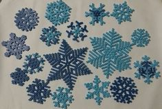 finally! my own snowflakes... perler royal blue pearl stripes and perler sky blue stripes! ♡♡♡