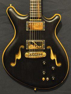 Alexander James Guitars - Custom guitar luthier specializing in custom guitars and instrument repair.