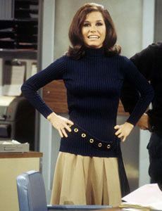 Mary Tyler Moore, original working girl. Love the sweater/pleated skirt combo.