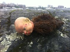 At a beach in Victoria British Columbia. | The Creepiest Collection Of Doll Photos Ever Assembled