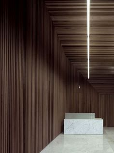 reception and dark timber wall