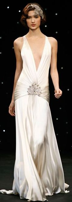 Gorgeous white 1920's updated flapper gown. The pleated silk at the hips with crystals embellishment is simply beautiful.