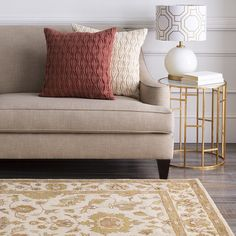 Mixing accessory styles in a consistent color palette creates an updated and cohesive look. Table lamp, pillows and rug from Surya!