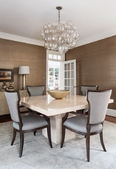 Textured wall paper is a great touch in a dining room