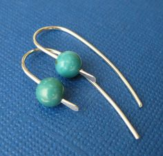 "Cute Simple Modern Silver and Turquoise Earrings. They measure about 1.5"" inches. $18"