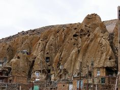 Kandovan, Iran, 13th century, eastern Iranian province of Azerbaijan. cone-shaped, naturally formed compressed volcanic ash formations that make the landscape look like a gigantic termite colony. troglodytes. They are generally 2 to 4 floors high, that has an animal shelter in the ground floor and the upper floors are used as living rooms, keeping the top most room for storage. To keep the caves remain cool in summer and warm in winter hardens pillar was used to build the caves