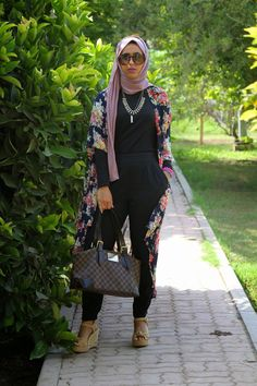 A basic black jumpsuit with floral cardigan