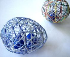 Surprise String Easter Eggs.  Place candy in a water balloon, inflate balloon, then attach string, twine, or yarn to the outside with a sugar or glue mixture.  Once dry, pop and extract the balloon and you'll be left with a candy-filled egg!