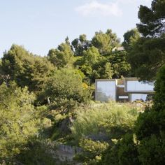 Concrete house in Maison Le Cap features  mirrored glazing to reflect the seaside scenery