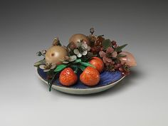 Dish of Fruit and Peach Blossoms, Qing dynasty (1644–1911). Chinese. The Metropolitan Museum of Art, New York.Gift of Heber R. Bishop, (1902(02.18.746).