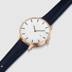 The pairing of a rose-gold 34mm stainless-steel case and a navy strap made from Italian leather provide a unique take on a classic watch design. #watches #design #rosegold