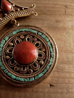 Tibetan coral and turquoise inlaid pendant