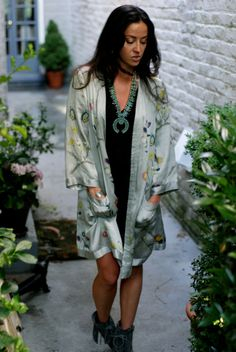 Wearing squash blossom necklace and silk robe jacket