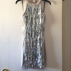 "Beautiful Bebe dress Grey with beautiful silver design!! Ultra class yet sexy dress. Special edition. Only worn twice. Comes with wooden Bebe hanger.   🌺🙆🏼PLEASE:  Feel free to ask questions regarding details/dimensions/to model/more photos/bundling.   🚫🙅🏼PLEASE DO NOT: Ask for lowest, to trade, or p p. I love going back and forth with offers asked privately but will no longer answer any ""lowest"" comments.   Thanks and HAPPY POSHING!!  🎀👙👛👠👗💍💖 ❌⭕️❌⭕️ bebe Dresses"