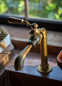 cold only faucet for our backyard bar and grill (Cooter's) Gorgeous brass faucet available at Hoffman Woodward, a lovely shop in East Berlin PA.