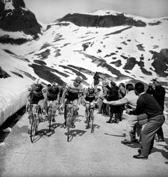 RAYMOND POULIDOR and FEDERICO BAHAMONTES lead the pack during the 1963 Tour de France. Photo by Roger Viollet.