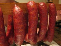 HOMEMADE SMOKED ANDOUILLE SAUSAGE RECIPE ~ This version of Andouille includes pork shoulder meat seasoned with a fair amount of fresh onion and garlic, plus just a little cayenne, thyme, mace, clove, allspice and dry mustard. The procedure is basically the same as for making Italian Sausages, except that the meat mixture gets put through a smaller die giving it a finer texture.~~
