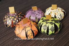 Easy (and cheap) paper pumkins!  And I was just whining about mini pumkins costing $1 each everywhere...