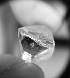 An octahedron crystal, the natural habit of diamond rough. Notice the triangular growth marks called trigons. From the Oppenheimer Collection at GIA Carlsbad. Photo by Monte Stern. Diamond Icon, Uncut Diamond, Rough Diamond, Raw Gemstones, Minerals And Gemstones, Quartz Crystal, Jewelery, Rings For Men, Wedding Rings