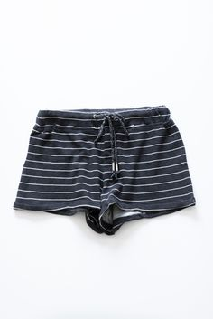 Charcoal and white striped knit shorts with an adjustable drawstring and stretchy waistband. Made with super comfy french terry knit material. High waistline. - 85% Cotton 15% Polyester - Imported