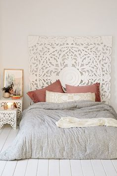 I love this big romantic headboard -  Grand Sienna Headboard - but I would prefer it against a bolder color choice on the wall to really make it pop - even gray would be a good choice although I'd prefer a turquoise shade.