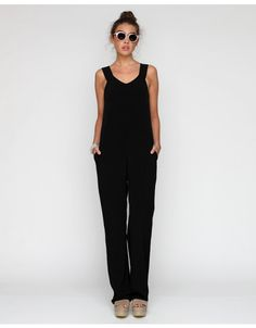 "Silky long jumpsuit from T by Alexander Wang. Features tank top styling with side zip entry, two side pockets and slouchy fit.  100% Viscose Dry clean only  16.5"" pit to pit 61"" shoulder to hem 33"" inseam 9.5"" leg opening  Measurements taken fro"
