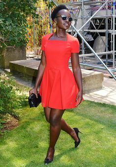 Lupita Nyong'o wears a red dress, black pumps, clutch, and Dior sunglasses Dior So Real Sunglasses, Celebrity Sunglasses, Flat Top Sunglasses, Summer Sunglasses, Dress For You, Dresses For Work, Corporate Wear, Valentino Dress, Top Celebrities