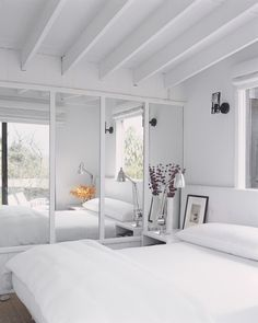 Sliding mirror doors and reflective paint help toss light around and make rooms feel more expansive.