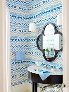 Snazzy blue, white and yellow wallpaper in a powder room.  Via House Beautiful by James Merrell