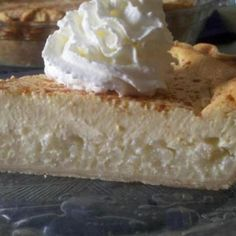 Rice pie(along with Ricotta pie) is our family's traditional Easter dessert. Like many Italian desserts, it is simple and not very sweet. The rice settles to the bottom leaving a custard-like layer on top. A very satisfying dessert. A dollop of sweetened whip cream is a perfect topper. Enjoy!