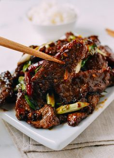 Mongolian Beef, by thewoksoflife.com - now to make this gluten free and refined sugar free, easy enough!  Swap out coconut aminos for the soy sauce and swap out raw honey or pure maple syrup for the brown sugar.