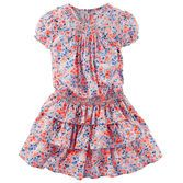 Sweet for spring, this bright blooming dress features tiered ruffles and smocking at the neckline and waist for a hint of structure.