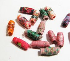 You make fabric beads the same way you make rolled paper beads, but I prefer fabric. I haven't had any success when I tried making paper beads (yet). It's easier to roll the fabric, and the beads get chunkier faster. Art Textile, Textile Jewelry, Fabric Jewelry, Beaded Jewelry, Jewellery, Beaded Bracelets, Make Paper Beads, How To Make Beads, Paper Beads Tutorial