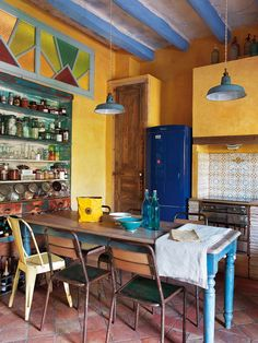 kitchen and dining room, mismatched chairs, yellow painted walls