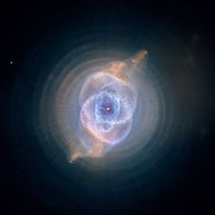 "In this detailed view from the NASA/ESA Hubble Space Telescope, the so-called Cat's Eye Nebula looks like the penetrating eye of the disembodied sorcerer Sauron from the film adaptation of ""Lord of the Rings."""