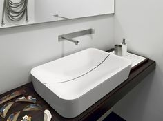 scarabeo-re-interprets-the-common-sink-drain-design-2.jpg
