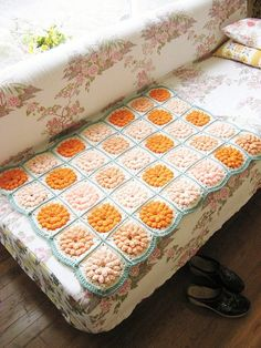 pretty crochet flower blanket, and that couch!