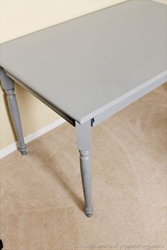 Table spray painted with Krylon Classic Gray.  Quick revamp project and great color. Domestically Speaking
