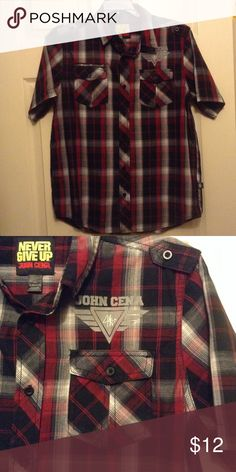 John Cena button down shirt Stylish short sleeve, button down top from WWE superstar John Cena's Never Give Up collection. Has a button closure pocket on each side of the chest. Color scheme includes deep red, black, gray, and white.55% cotton/45% polyester. Like new condition! Shirts & Tops Button Down Shirts