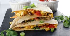 Vegan Black Bean & Corn Quesadilla! Spiced black beans and corn, on top of a homemade melty dairy-free cheese, with diced tomato...