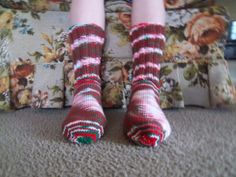 Here is a wonderful pair of hand knit adult size socks. Heel to toe is approx. 9 1/2 in. and the ribbing on the top (top to ankle) is approx. 6 1/2 in. The yarn color is called Mistletoe. These socks are made of 100% acrylic yarn and can be machine washed and dried.