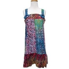 Convertible Dress Made in Ghana. You can wear this innovative dress as a mini, with wide straps that button in front, or convert it into a skirt! Get this Festival Dress just in time for Summer!
