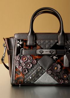 Americana-inspired quilting is blown-out in three dimensions, updating the coveted Coach Swagger with texture and craft.