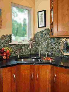Eye Candy: 11 Totally Unique DIY Kitchen Backsplash Ideas   Can't completely remodel your #kitchen? Consider some of these unique and visually stunning #backsplash options. #DIY