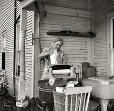"July 1940. ""Farm woman washing clothes in her motor-driven washing machine. Near Lincoln, Vermont."" Sliver gelatin print by Louise Rosskam"