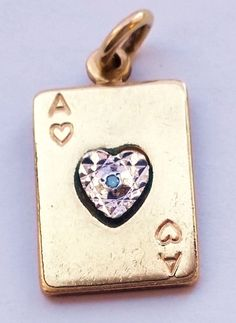 JulesJewels welcomes you to browse our items! This is a fantastic old gold filled ace of hearts card bracelet charm with diamond center.  Good Luck